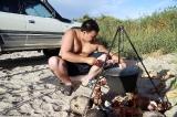 Шеф-повар за приготовлением барана